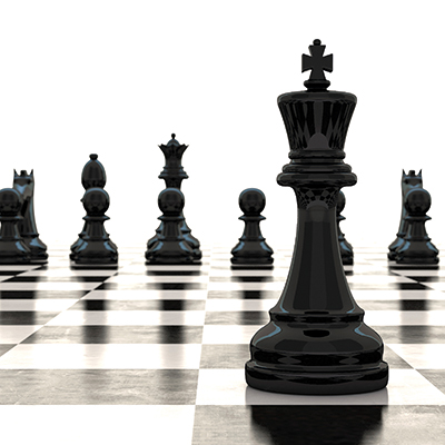 Black Chess piece facing other chess pieces across the board